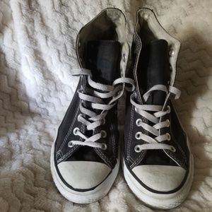 High top black Converse shoes